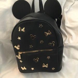 Disney black with gold hardware backpack